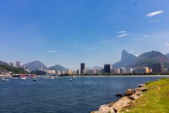 Panoramic morning view of the beach and Botafogo cove with its buildings, boats and mountains in Rio de Janeiro. Panoramic morning view of the beach and Botafogo royalty free stock photos