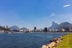 Panoramic morning view of the beach and Botafogo cove with its buildings, boats and mountains in Rio de Janeiro. Panoramic morning view of the beach and Botafogo royalty free stock photo