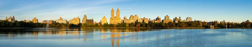 Upper West Side skyline and Central Park Reservoir, New York City panoramic. Panoramic morning view of the Upper West Side with the Jacqueline Kennedy Onassis Royalty Free Stock Images