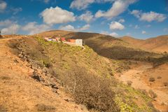 Panoramic Moroccan landscape with hills and cactuses stock photography