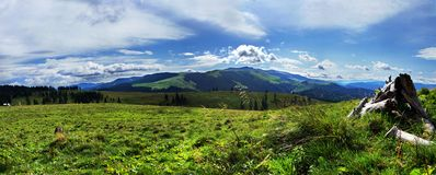 Panoramic mountain view. Panoramic moubtain view over clouds Stock Image
