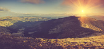 Panoramic mountain landscape in morning. Panoramic mountain landscape in morning at sunshine Royalty Free Stock Photo