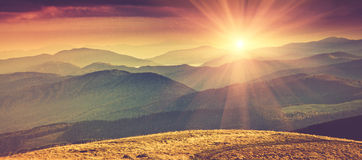 Panoramic mountain landscape in spring with sunlight. Royalty Free Stock Images
