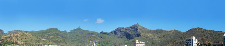 Panoramic mountain range in Mauritius. View of a mountain range at Champs de Mars in Port Louis Stock Photos