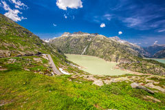 Panoramic mountain road leading to Grimselpass with Grimselsee in Swiss Alps Royalty Free Stock Images