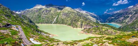Panoramic mountain road leading to Grimselpass in Swiss Alps Royalty Free Stock Photos