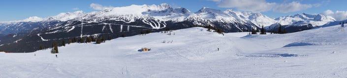 Panoramic Mountain View. Panoramic view from Whistler Mountain to Blackcomb Mountain Range showing ski slopes Stock Photos
