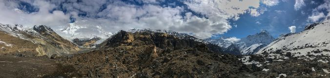 Panoramic mountain view from Annapurna Base camp. Panoramic scenic view of Annapurna and Machapuchare mountains royalty free stock images