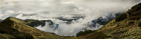 Panoramic mountain view. Panoramic moubtain view over clouds Royalty Free Stock Image