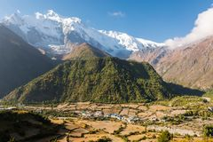 Panoramic mountain view with village. Stock Image