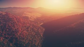 Panoramic mountain wood slope sunset aerial view stock video footage
