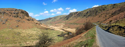 Panoramic narrow country road in Wales, UK. Panoramic narrow country road through the hills to Tregaron in Wales, UK Royalty Free Stock Photos