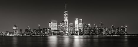 Panoramic of New York City Financial District skyscrapers in evening Black & White. Black and White panoramic view of New York City Financial District Stock Photos