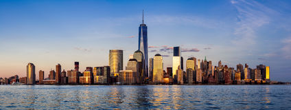 Panoramic of New York City Financial District skyscrapers at sunset. Panoramic of New York City Financial District skyscrapers and Hudson River at sunset. Lower Royalty Free Stock Photography