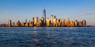 Panoramic of New York City Financial District skyscrapers at sunset Stock Images