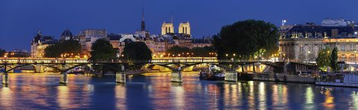 The night view of Seine river during the night with some famous touristic bridges like Pont des Arts and Pont Neuf