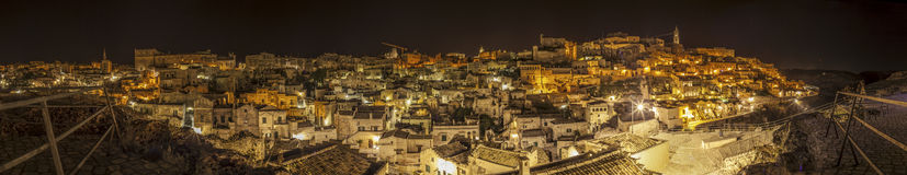 Panoramic nocturnal view of Matera, Italy Stock Photos