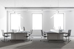 Panoramic office interior, gray. Panoramic office interior with white walls, loft windows, a gray floor and rows of computer tables. 3d rendering mock up Stock Photo