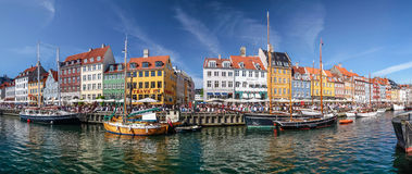 Panoramic of old boats and houses in Nyhavn in Copenhagen Stock Image