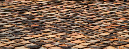 Panoramic, old red brick roof tiles. Panorama Royalty Free Stock Photo
