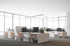 Panoramic open space office corner. Modern white wall open space office corner with a concrete floor, rows of computer tables and panoramic windows. 3d rendering Royalty Free Stock Photo