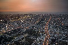 Panoramic Osaka cityscape in orange sky twilight time, with street, movement light, building and landmark. Panoramic Osaka cityscape in orange sky twilight time stock image