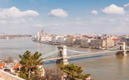 Panoramic overview of Budapest on foreground the Parliament building and chain bridge. Panoramic overview of Budapest on foreground the Parliament building and Royalty Free Stock Photo