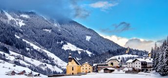 Panoramic overview church snowy valley beautiful winter sunny day Trentino Alto Adige Italy royalty free stock images