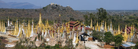 Shwe Inn Thein Paya - Ithein - Myanmar (Burma). Panoramic overview of the Shwe Inn Thein temple complex at Ithein (Indein) near Inle Lake in Shan State in Stock Photography