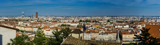 Panoramic overview to Lyon city, orange roofs and new buildings Stock Photos