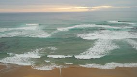 Panoramic pan shot of the beach on Great Ocean Road in Australia at sunset stock video