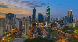 Panoramic Panama City at Night. The colorful panoramic skyline of Panama City at sunset with high rise skyscrapers, Panama, Central America stock photo