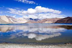The panoramic Pangong Lake. Panoramic view of the Pangong Lake with crystal clear blue, turquoise waters, located at an altitude of more than 14,000 feet above Stock Photos