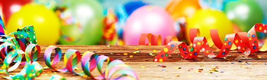 Panoramic party banner with balloons and streamers. Panoramic party banner with colorful balloons, scattered confetti and twirled streamers royalty free stock photo