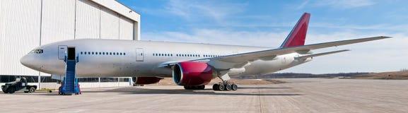 Panoramic passenger airplane Stock Photos