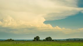 Panoramic perfect landscape field with sunset clouds time lapse stock video footage