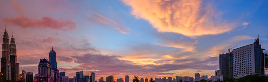 Panoramic Petronas Towers at Sunset and Blue Hour Stock Photo