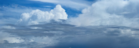 Panoramic photo of blue sky with white cumulus clouds Royalty Free Stock Photos