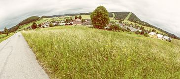 Panoramic photo of Cicmany village, yellow filter. Panoramic photo of Cicmany village, Slovak republic. Folklore theme. Rural landscape. Travel destination Stock Photos