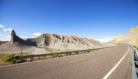 Panoramic photo of a desert road Stock Photos