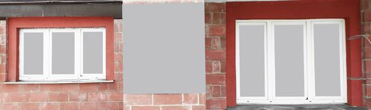 Panoramic photo.an empty poster between the Windows of the house.  stock photography
