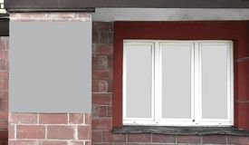 Panoramic photo.an empty poster between the Windows of the house.  royalty free stock photography