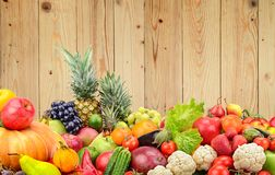 Panoramic photo healthy vegetables and fruits against wooden wal Royalty Free Stock Photos