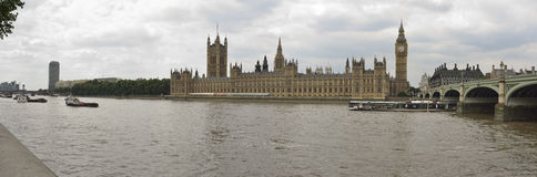 Panoramic photo of the houses of parliament and Westminster bridge in London. Royalty Free Stock Photography