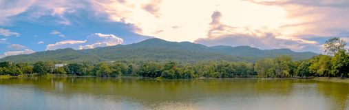 Panoramic photo of lake and mountain scenery with beautiful sky. From the shining clouds, landscape stock images