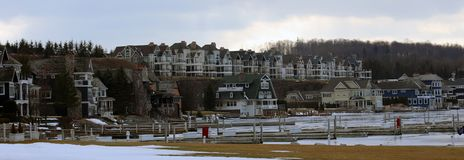 Panoramic photo of a lake town during winter. Lake house new buildings Royalty Free Stock Photography