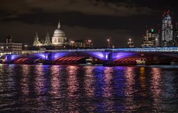 Panoramic photo of the London skyline at night, showing The River Thames, Blackfriars Bridge and St Paul`s Cathedral royalty free stock photo