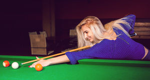 Panoramic photo lovely blonde girl playing on the pool table Royalty Free Stock Photos