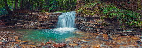Panoramic photo of Manyavsky waterfall. Carpathian, Ukraine Stock Photos