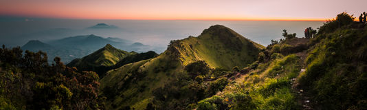 Panoramic photo of Mount Merbabu. Panoramic photo of dormant stratovolcano, Mount Merbabu, and surrounding mountains near Yogya in central Java province in Stock Photo